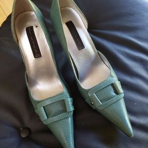 Teal pointed toe pumps with side cutout